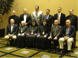 The Religious and Executive Councils: Seated, from left, Stephen Hagopian, Archpriest Fr. Aram Stepanian, Archbishop Oshagan, Bishop Anoushavan, Noubar Megerian, Sarkis Ohanessian. Standing, from left, Archpriest Fr. Gomidas Baghsarian, Armen Kourkounian, Hagop Antranigian, John Daghlian, Raffi Ourlian, Rev. Fr. Mesrob Lakissian