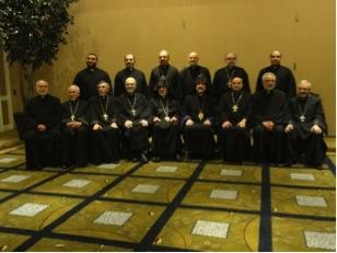 The clergy at the National Assembly: Seated from left, Rev. Fr. Sarkis Aktavoukian, Archpriest Fr. Aram Stepanian, Archpriest Zareh Sahakian, Archpriest Fr. Antranig Baljian, H. E. Archbishop Oshagan, H. G. Bishop Anoushavan, Archpriest Fr. Krikoris Keshishian, Archpriest Fr. Nerses Manoogian, Archpriest Fr. Khatchadour Boghossian. Standing from left, Rev. Fr. Hrant Kevorkian, Rev. Fr. Mesrob Lakissian, Rev. Fr. Hovnan Bozoian, Archpriest Fr. Gomidas Baghsarian, Rev. Fr. Bedros Shetilian, Rev. Fr. Stephan Baljian.