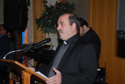 Rev. Mesrob Lakissian offering the Opening Prayer