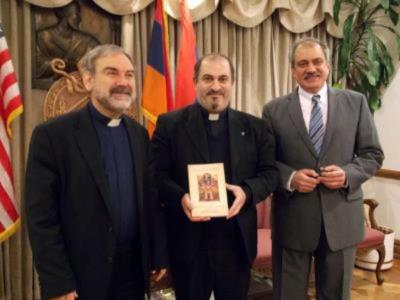 Bishop Anoushavan Tanielian presented the first copy of the Creed book to  Fr. Mesrob Lakissian. The book was sponsored by St. Illuminator's Cathedral.